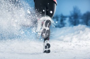 athlete woman is running during winter training outside in cold snow weather 300x199 5 Fitness Activities for the Winter